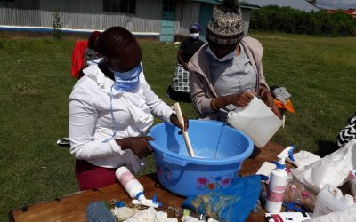 women making soap and sanitizer